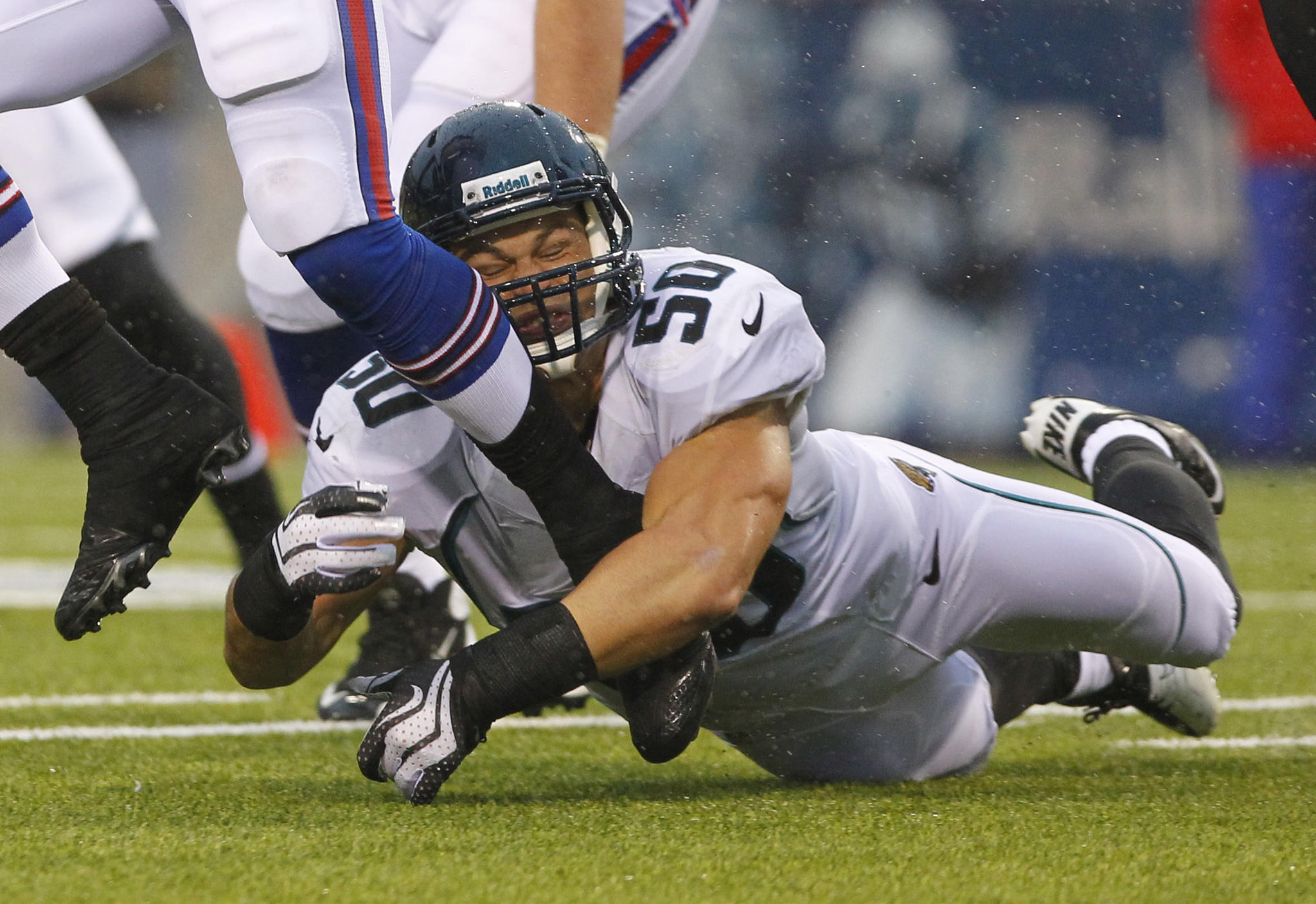 Russell Allen tries to make a tackle as the Jacksonville Jaguars play against the Buffalo Bills.