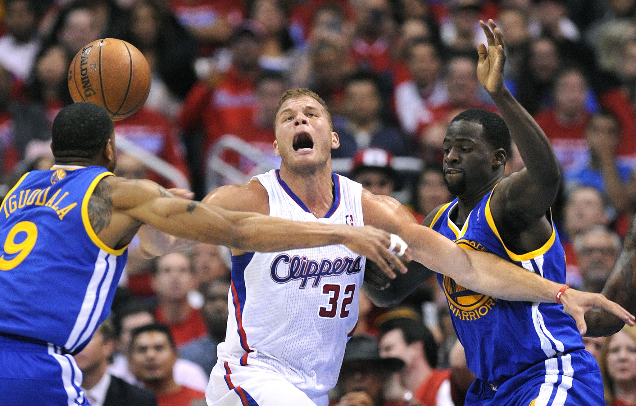Blake Griffin loses control of the ball against the Warriors' Andre Iguodala, left, and Draymond Green in Game 2 of their first-round playoff series at Staples Center.