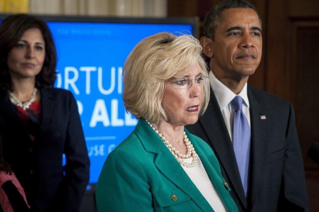 President Obama on April 8 listens as Lilly Ledbetter delivers remarks at a White House event marking Equal Pay Day.