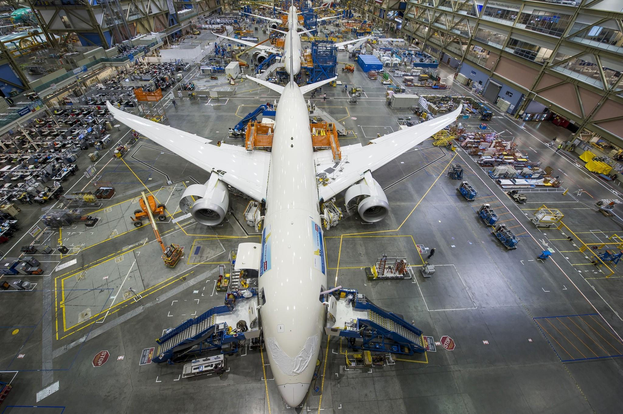 Boeing's profits are up this quarter as the Chicago-based aerospace company increases commercial jetliner production.