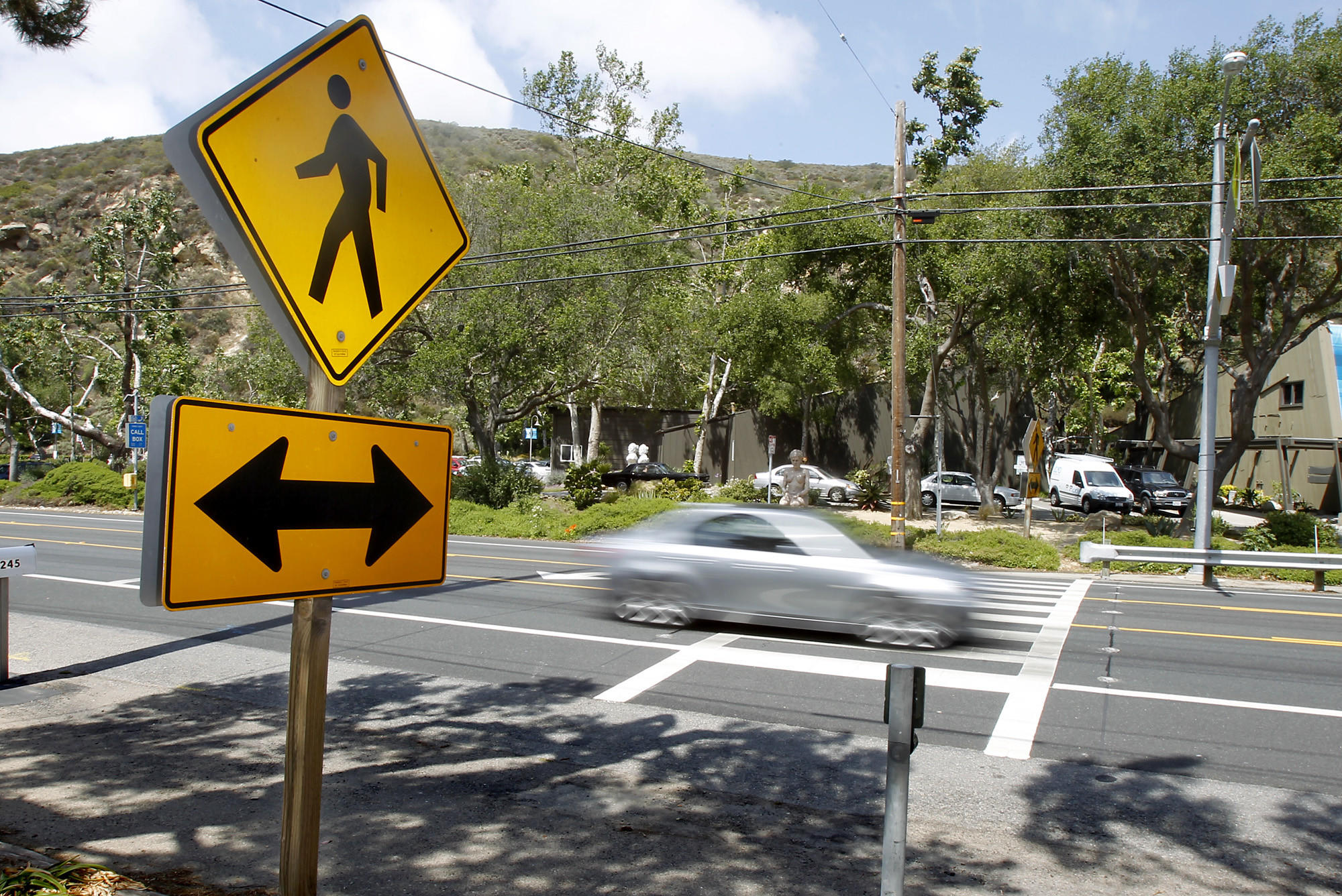 The flashing crosswalk in front of Laguna College of Art   Design on Laguna Canyon Road.