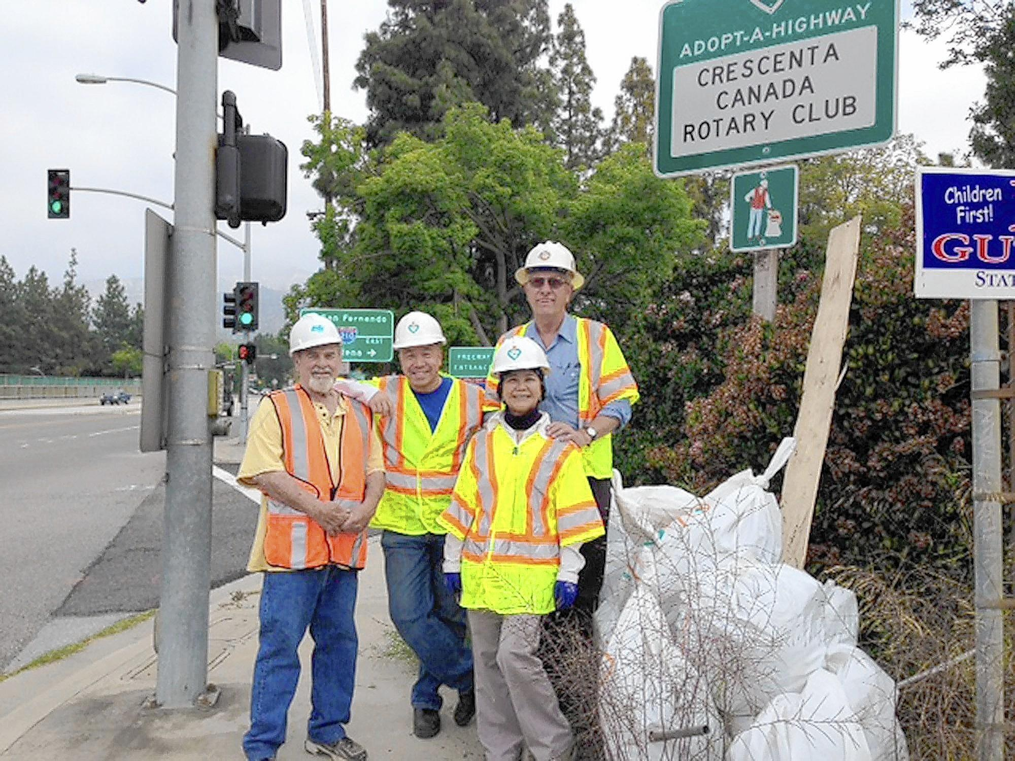 Members of the Crescenta Cañada Rotary Club, from left, Fred Konrad, Dennis Yen, President Robert Ippolito and President Elect Lynn Chen participated in Rotary at Work day on Saturday, April 12, 2104. Volunteers worked to clean up a stretch of Angeles Crest Highway in La Cañada Flintridge.