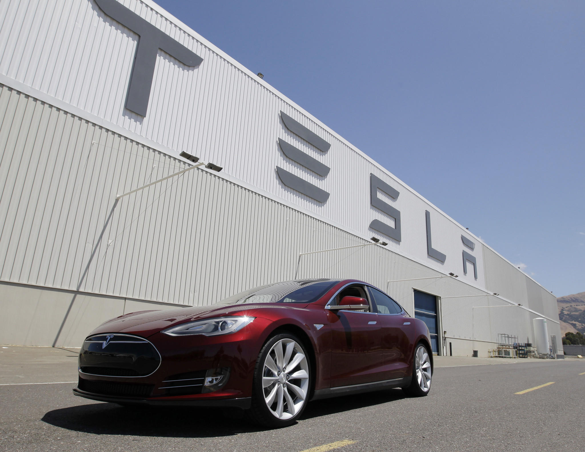 A Tesla Model S waits outside the Tesla factory in Fremont, Calif. Rumors are swirling that Tesla will begin making more cars in California at a facility the company has leased east of San Francisco in Lathrop.