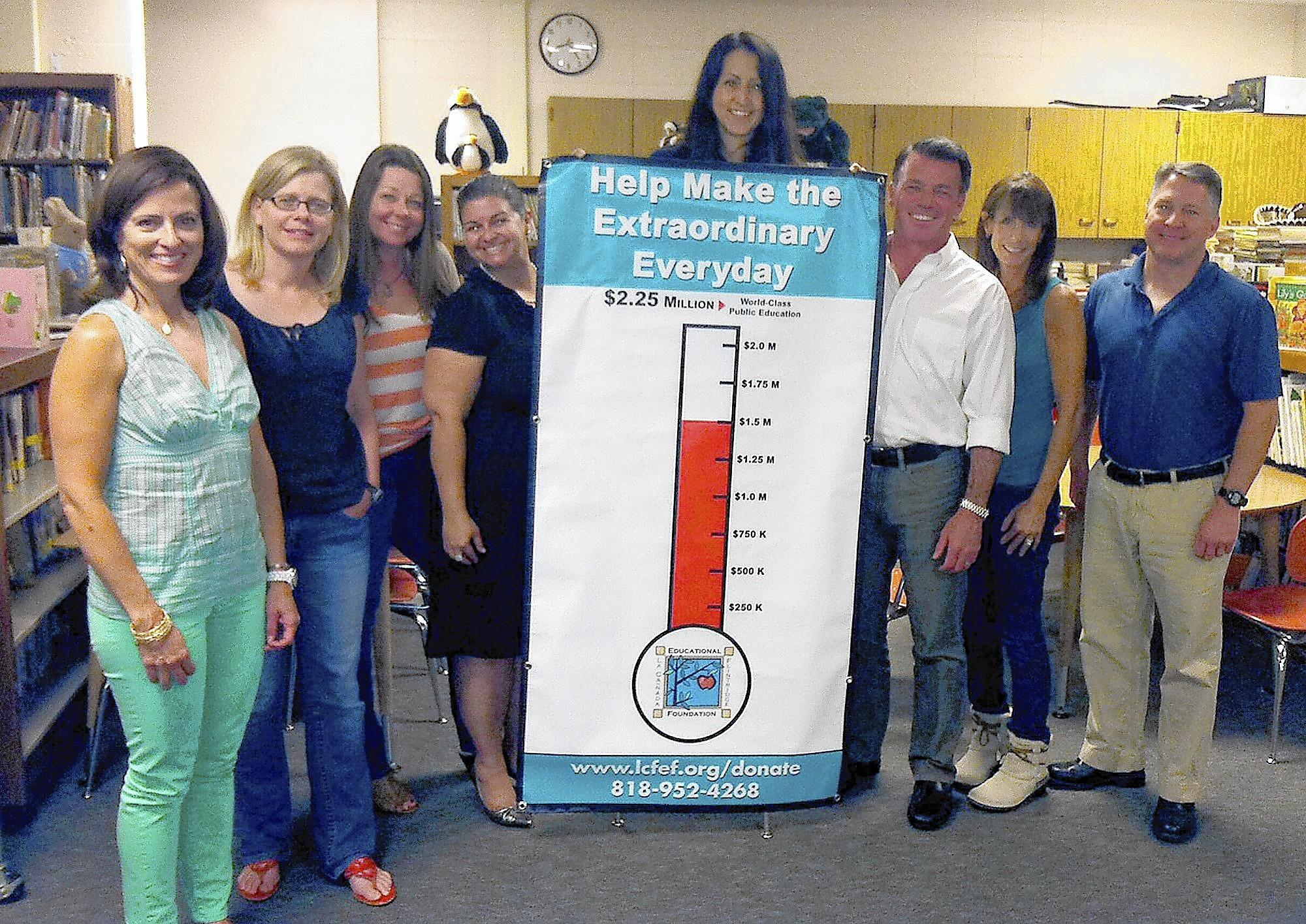 The La Cañada Flintridge Educational Foundation begins its spring phone fundraising campaign next week. Foundation directors looking ahead to the campaign are, photographed, Gina Ricci, Stephanie Fossan, Kelly McWilliams, Nina Ries, Paris Cohen, Steve Ingrassia, Betsy Hall and Brent Kuszyk.