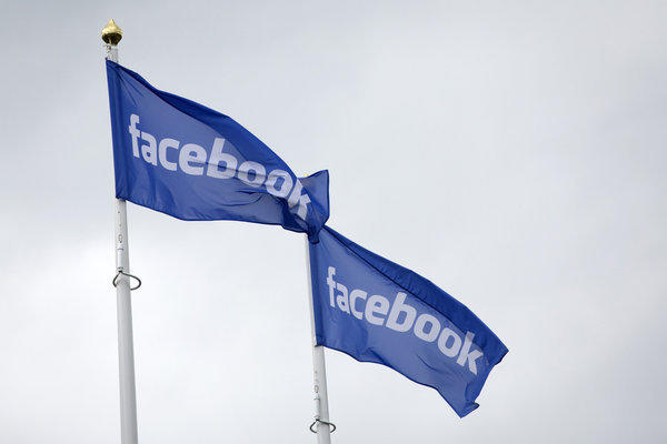 Facebook logos fly from flagpoles outside a Facebook data storage center in Sweden.