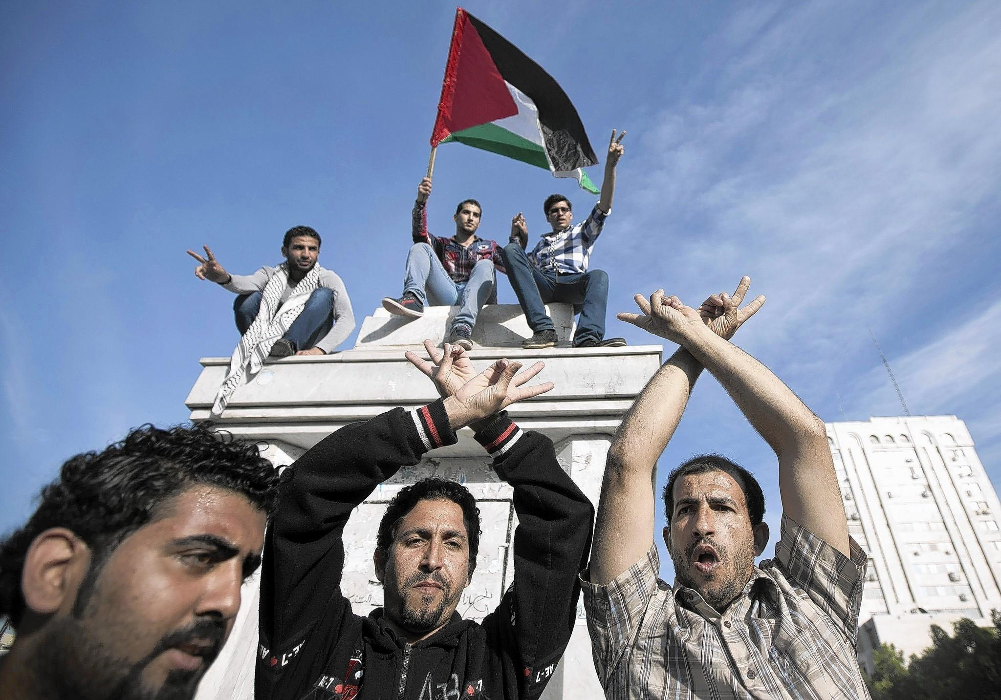 Palestinians in Gaza City celebrate the agreement to form a unity government.