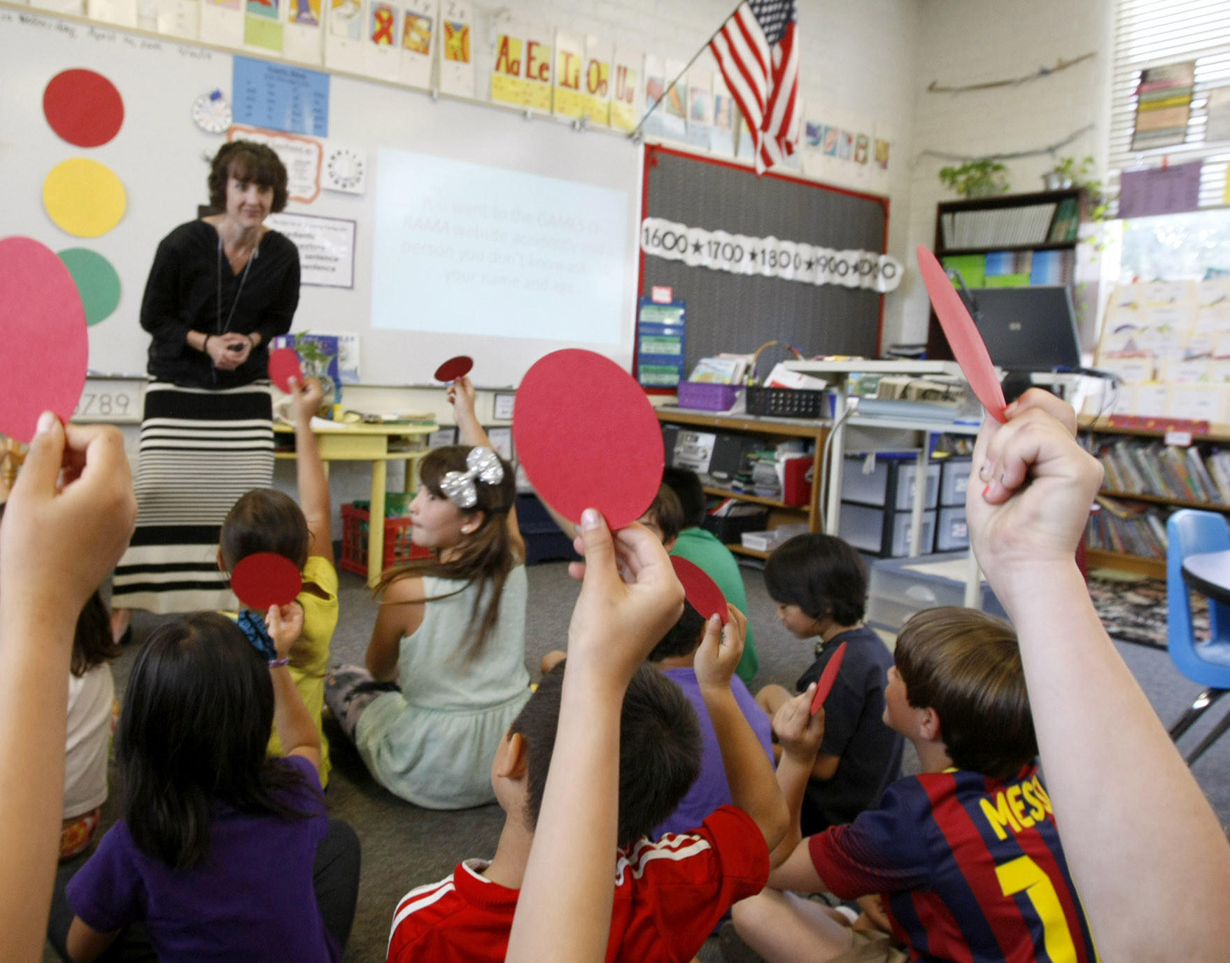 Second grade teacher Pam Watts teaches her students about digital citizenship in her Paradise Canyon Elementary School classroom in La Cañada Flintridge on Wednesday, April 16, 2014. Above, students answer a question with a red circle indicating the question was not a safe activity to do while on the internet. Her students are learning how to be safe and cautious while using the internet.