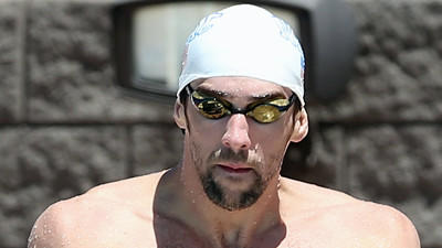 Michael Phelps says he's 'having fun' as he returns to the pool this week
