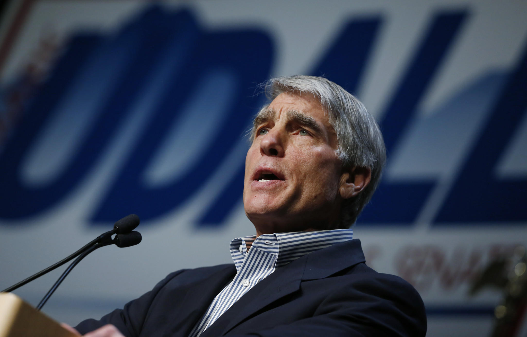 Democratic Colorado Sen. Mark Udall faces a potentially tough reelection fight. A conservative group apologized Wednesday for an advertisement using a grim-faced photo of Udall taken after the July 2012 shootings in Aurora, Colo.