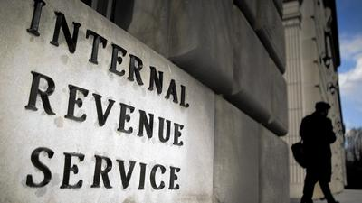 IRS workers who failed to pay taxes got bonuses, report says