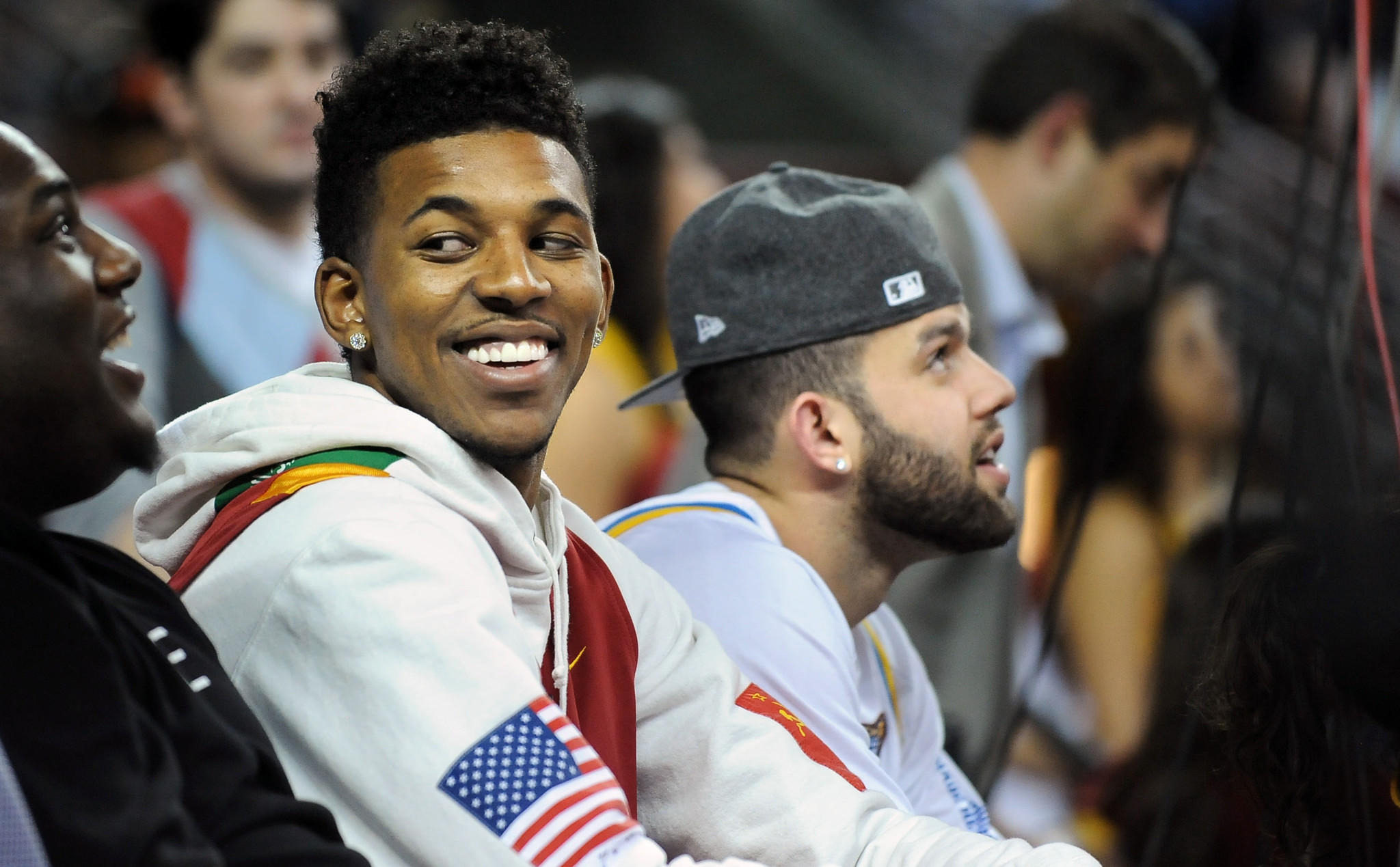 Lakers teammates Nick Young, left, and Jordan Farmar attend a USC-UCLA men's basketball game in February. They made more sporting rounds this week.