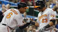Orioles hit four home runs in 10-8 win over the Toronto Blue Jays
