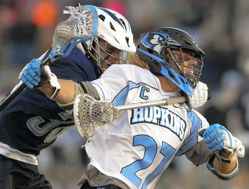 Villanova's Mark Jackson is called for a hold on Johns Hopkins' Robert Guida but the penalty is waved off following a Blue Jays goal in the first quarter.