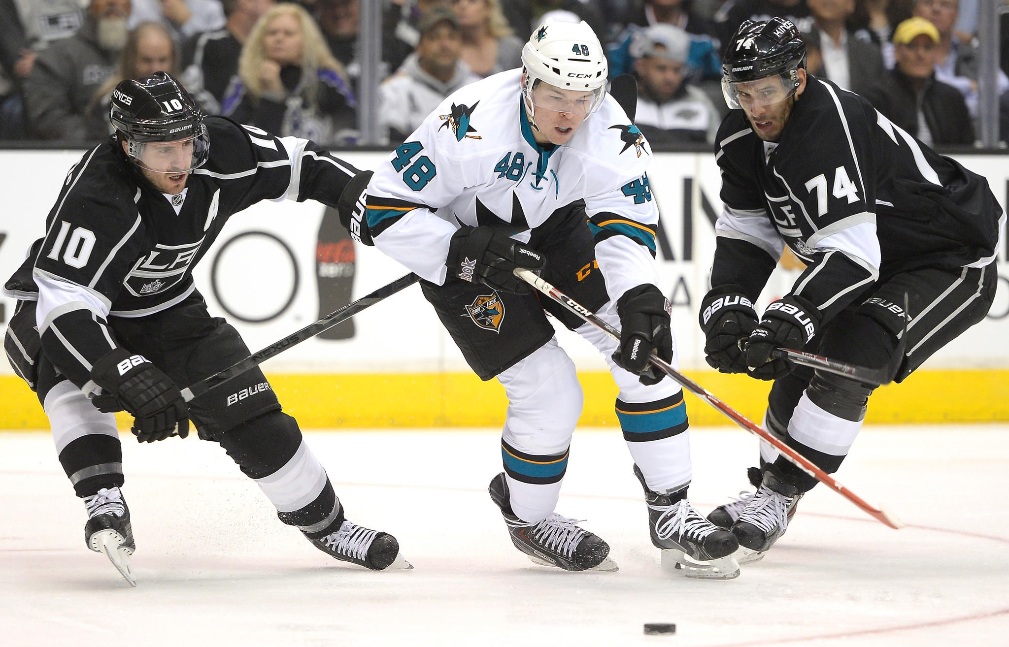 San Jose Sharks forward Tomas Hertl, center, controls the puck between Kings forwards Mike Richards, left, and Dwight King during the Kings' loss in Game 3 of the Western Conference quarterfinals Tuesday. The Kings played better in Game 3, but they still didn't win.