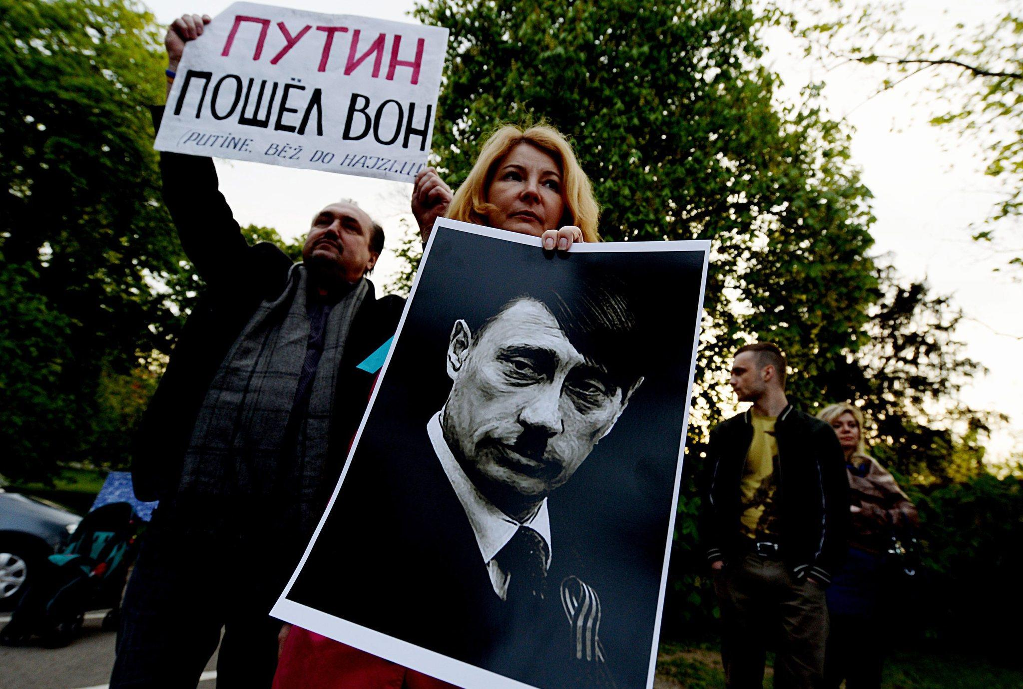 Protesters in the Czech Republic compare Vladimir Putin to Hitler in objecting to Russia's takeover of Crimea.