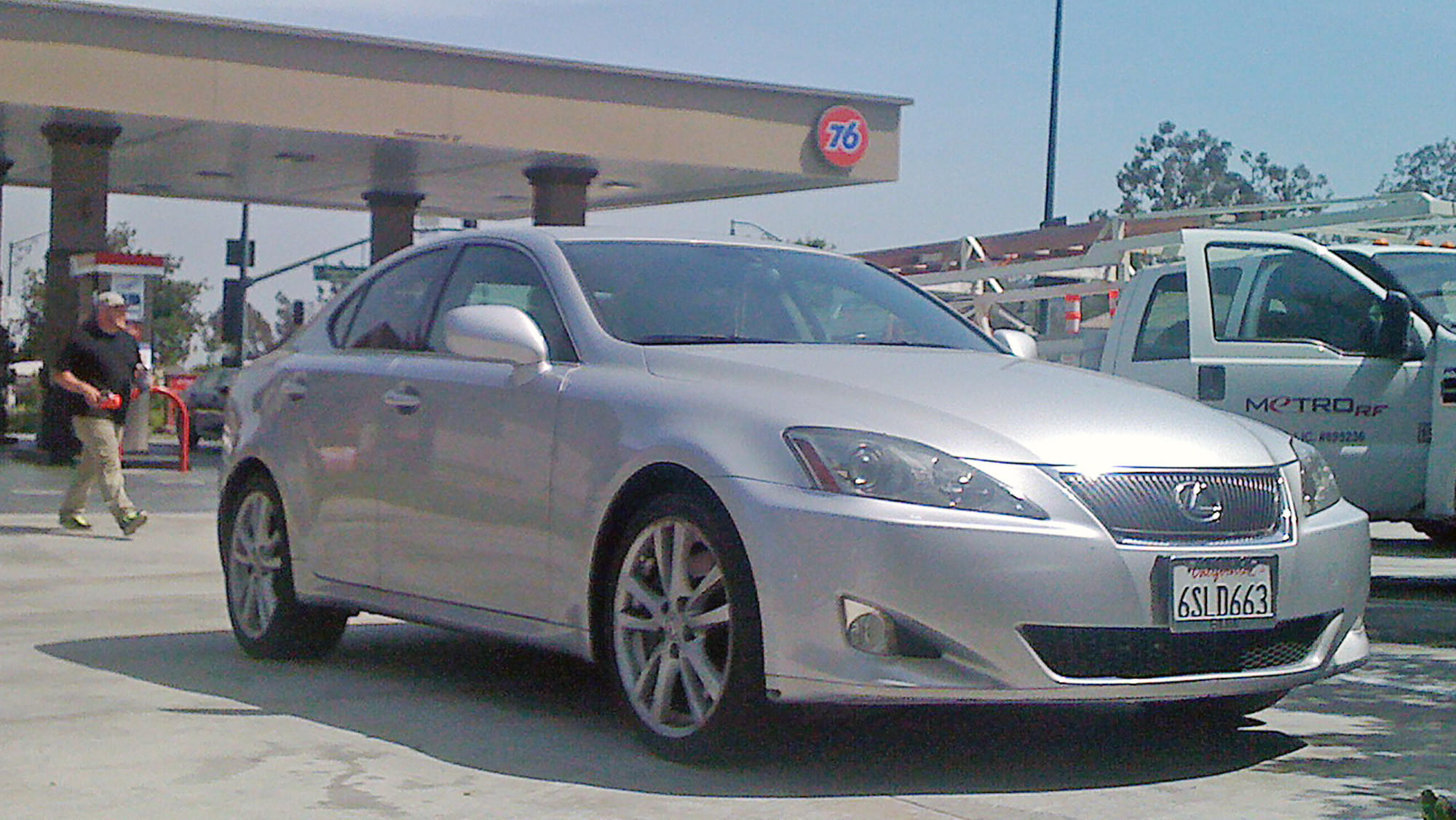 A Lexus driven by a man who was detained by police at gunpoint Wednesday, awaits retrieval outside the Union 76 gas station on Foothill Boulevard at Angeles Crest Highway.