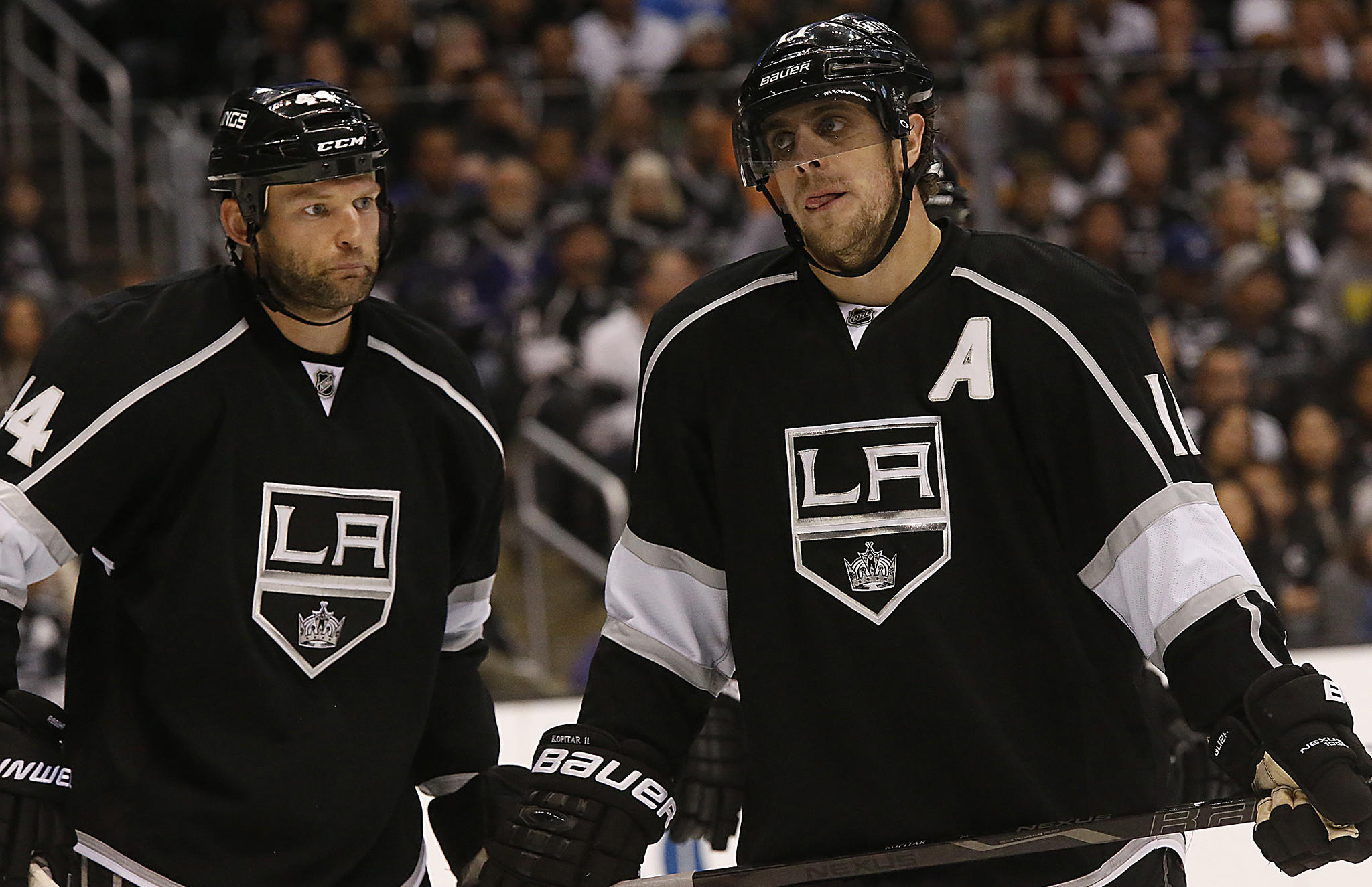 Kings teammates Robyn Regehr, left, and Anze Kopitar line up for a faceoff during the Kings' 4-3 overtime loss to the San Jose Sharks on Tuesday. The Kings' season will be on the line Thursday in Game 4 of the Western Conference quarterfinals.