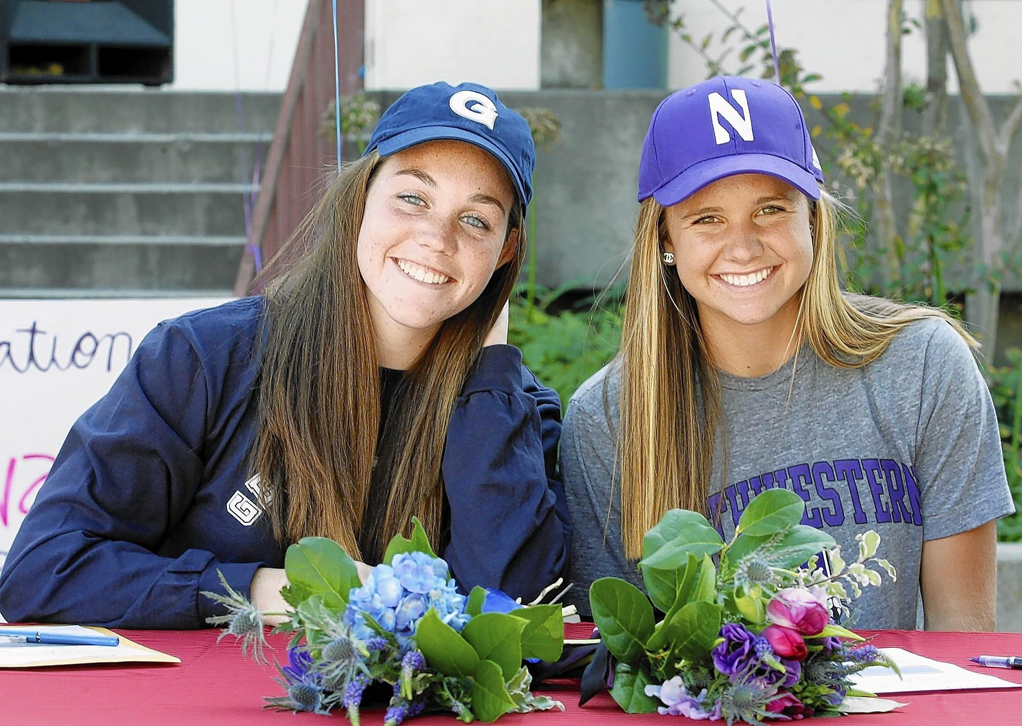 Lauren O'Leary and Anna Edwards smile for the photographers after they signed early letters of intent to for full-ride scholarships they earned for their prowess in softball on Tuesday, November 17, 2010. O'Leary will attend Georgetown in the Fall, and Edwards will attend Northwestern.