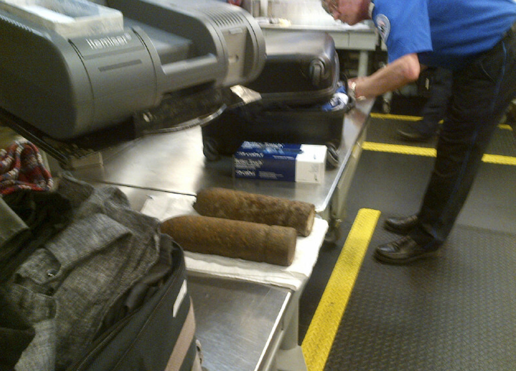 This photo provided by the Transportation Security Administration shows two World War I artillery shells discovered by baggage screeners in checked luggage that arrived on a flight from London at Chicago's O'Hare International Airport.