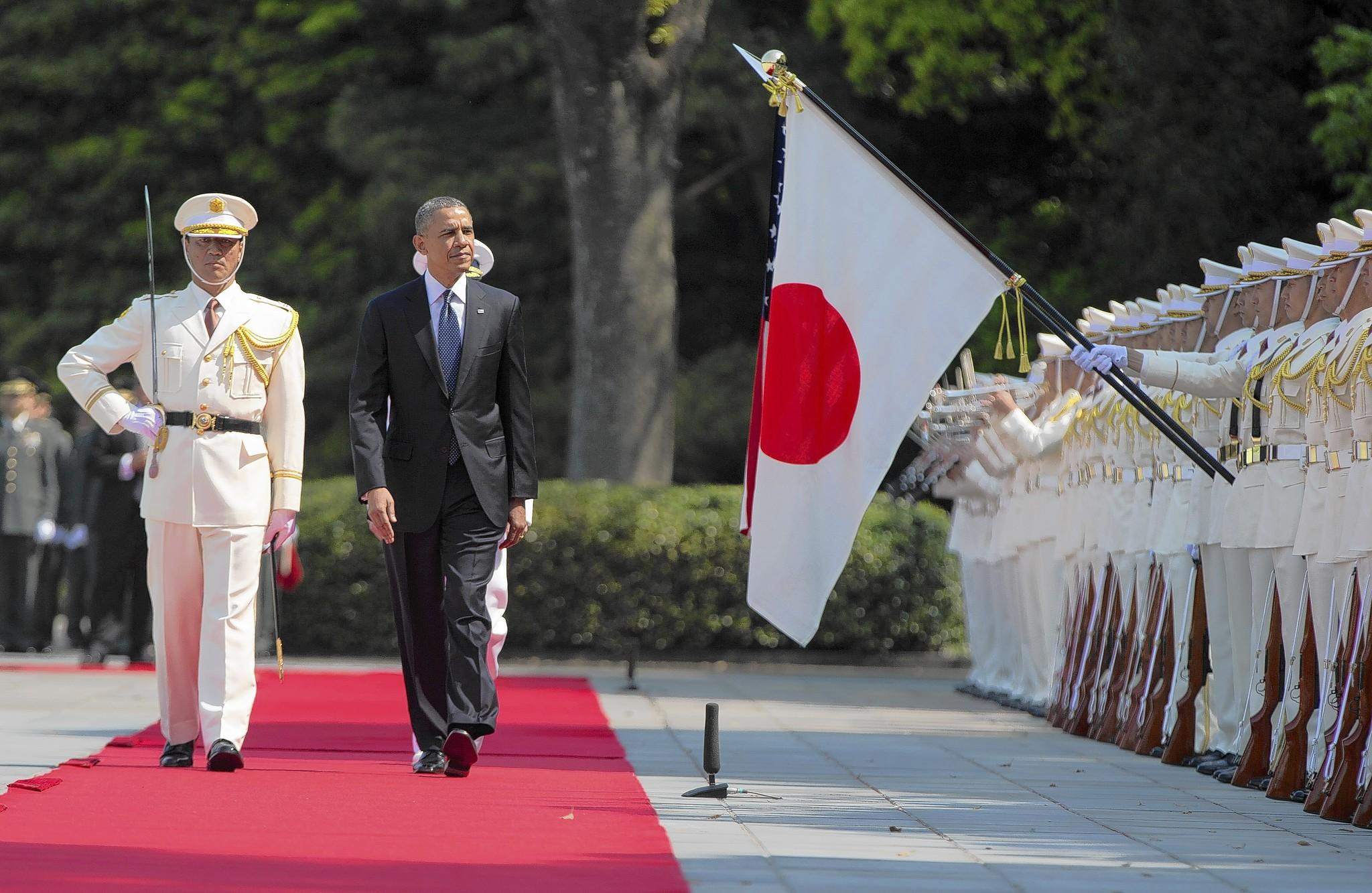 President Obama reviews troops during a welcome ceremony at the Imperial Palace in Tokyo on Thursday.