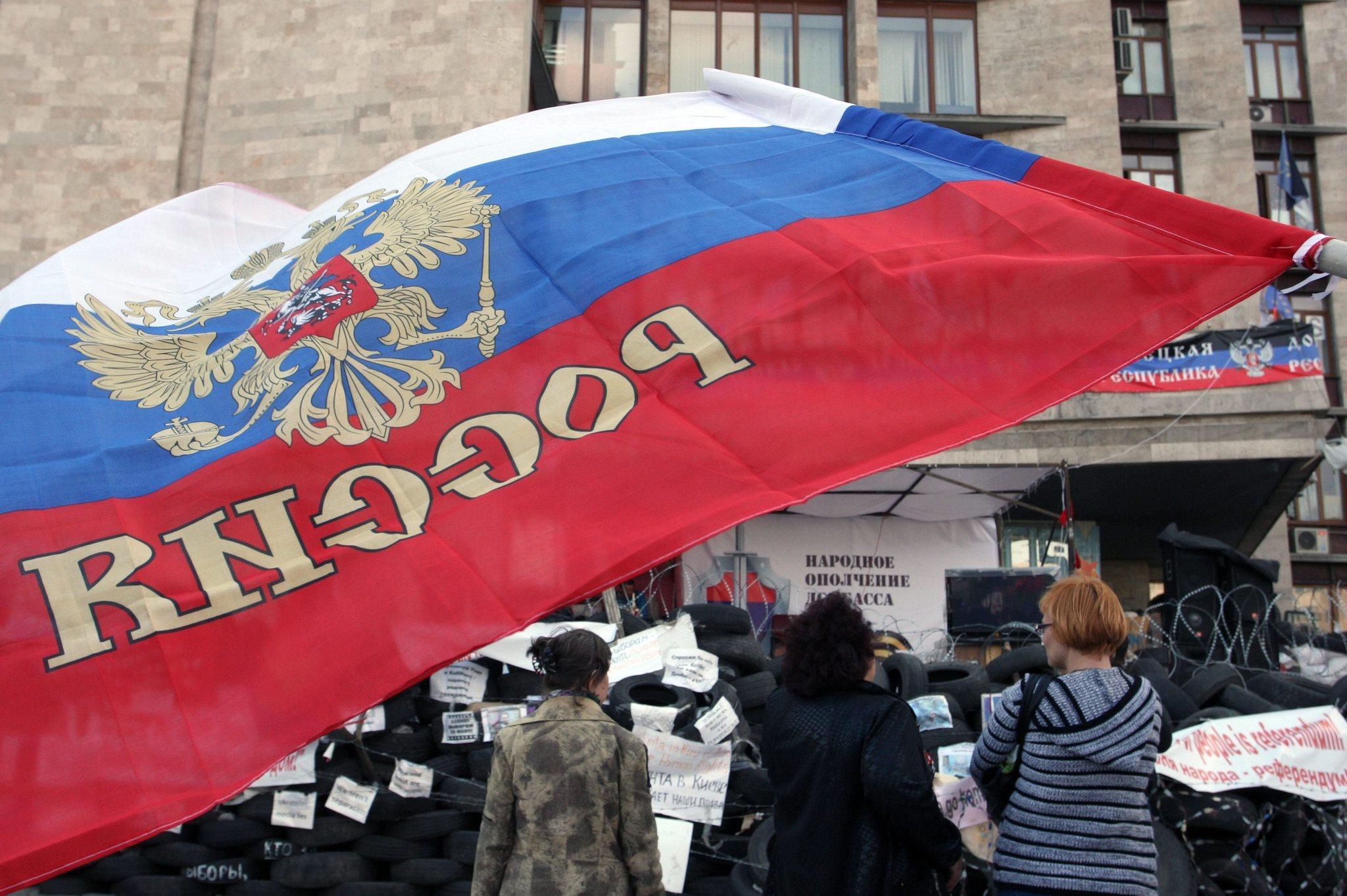 Pro-Russian protestors attend a rally in front of the occupied regional administration building in Donetsk, Ukraine.