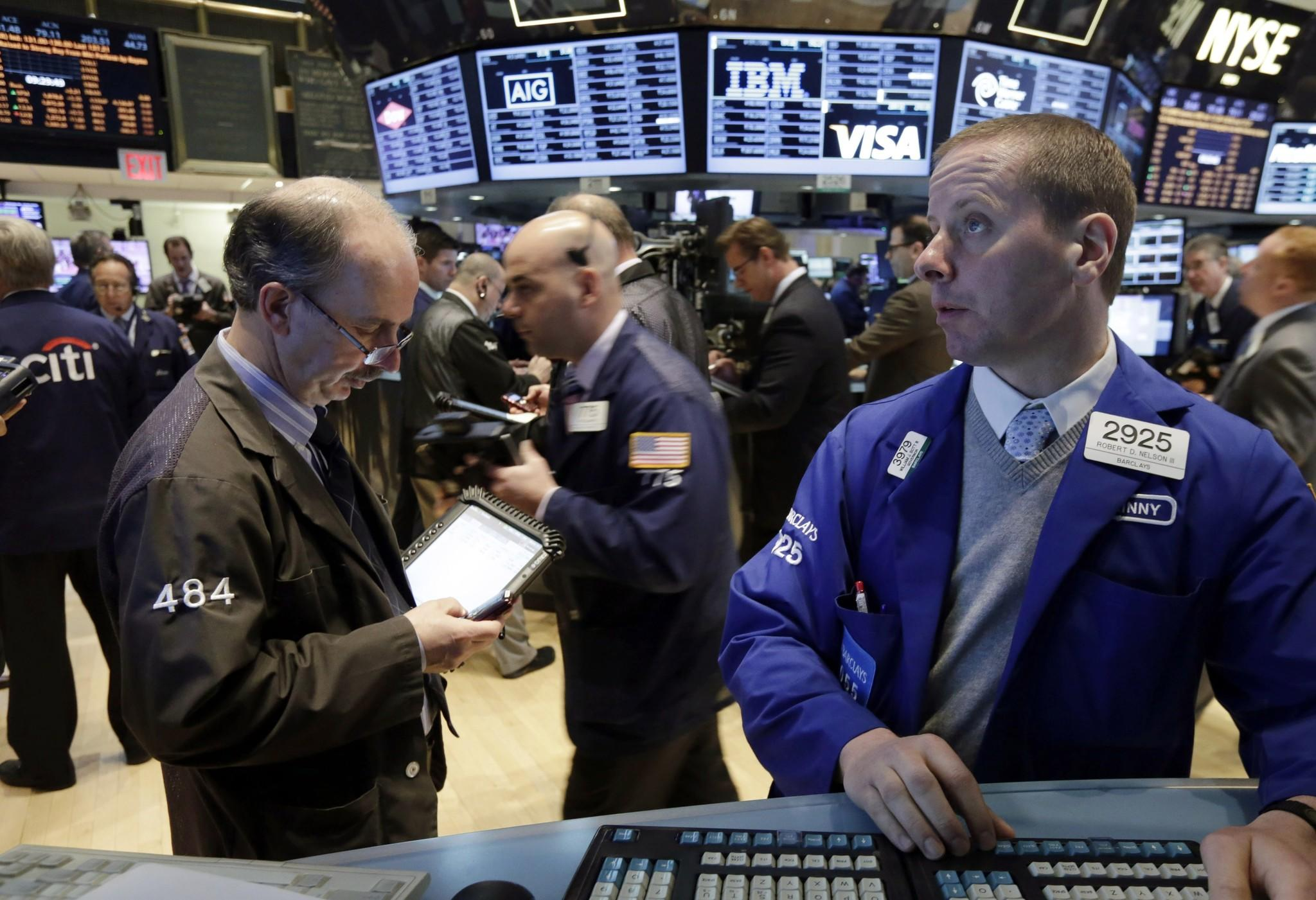 Zimmer Holdings shares were up more than 14% after it announced Thursday that it would acquire orthopedic products company Biomet in a deal valued at $13.35 billion. Pictured: Overall Thursday morning trading at the New York Stock Exchange.