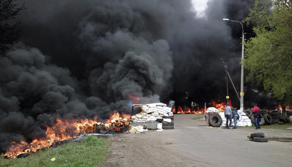 Black smoke billows from barricades outside the Ukrainian town of Slovyansk, set alight by pro-Russia gunmen as they were driven from the site by Ukrainian national forces trying to recover occupied towns and cities in the east of the country.