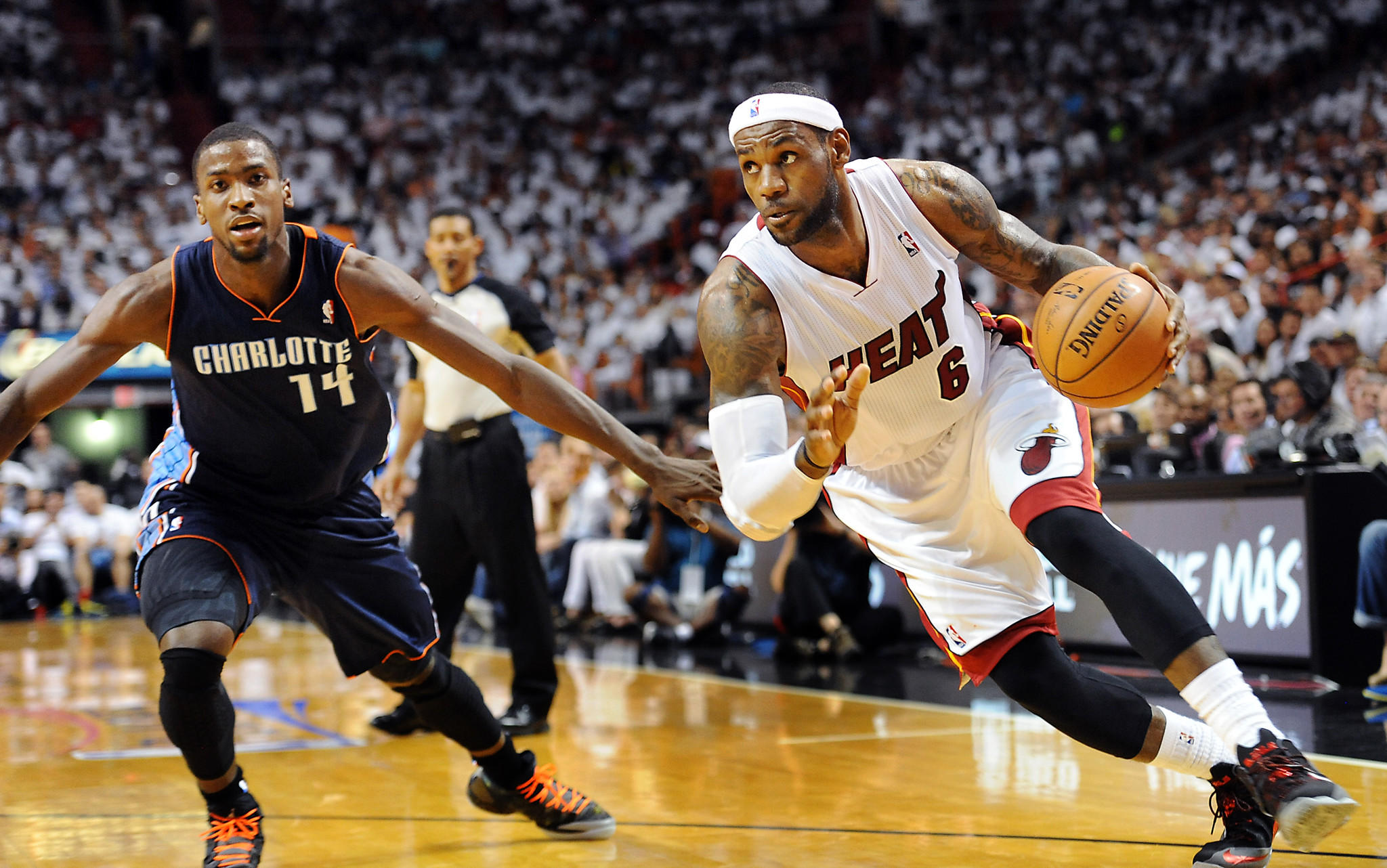 LeBron James blows past Charlotte's Michael Kidd-Gilchrist. The Miami Heat host the Charlotte Bobcats at American Airlines Arena for game two of the opening round of the NBA playoffs.