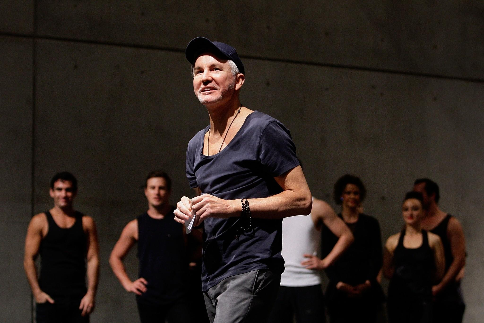 """Baz Luhrmann with cast members of the Australian musical """"Strictly Ballroom: The Musical"""" at Carriageworks in Sydney, Australia."""