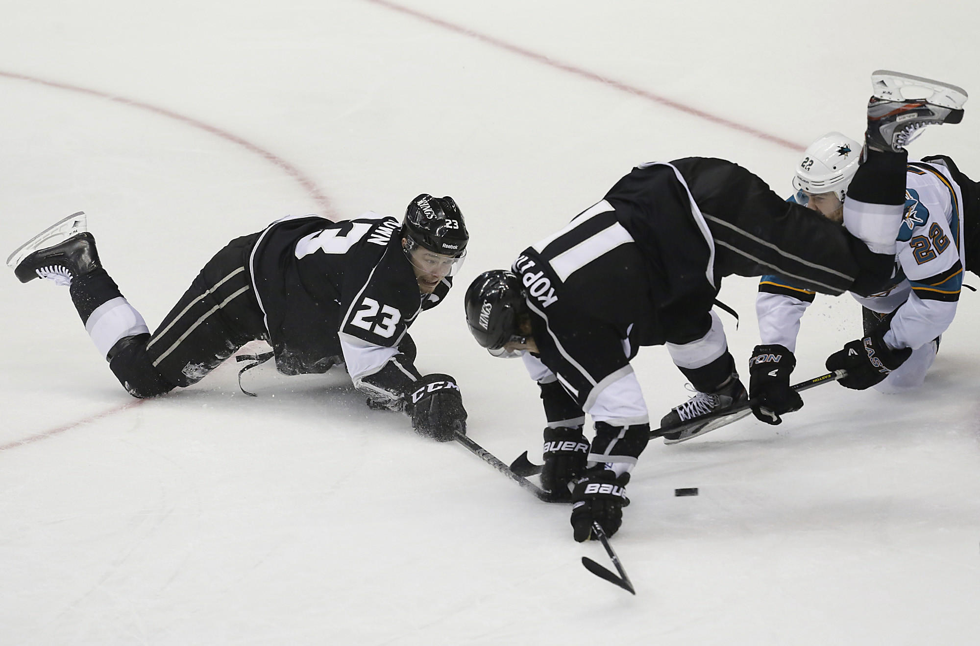 Dustin Brown, left, and Anze Kopitar, center, will be together again on the ice for the Kings tonight.