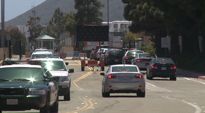 The Navy submarine base in San Diego was locked down Thursday after reports of a gun. Two people were taken into custody.