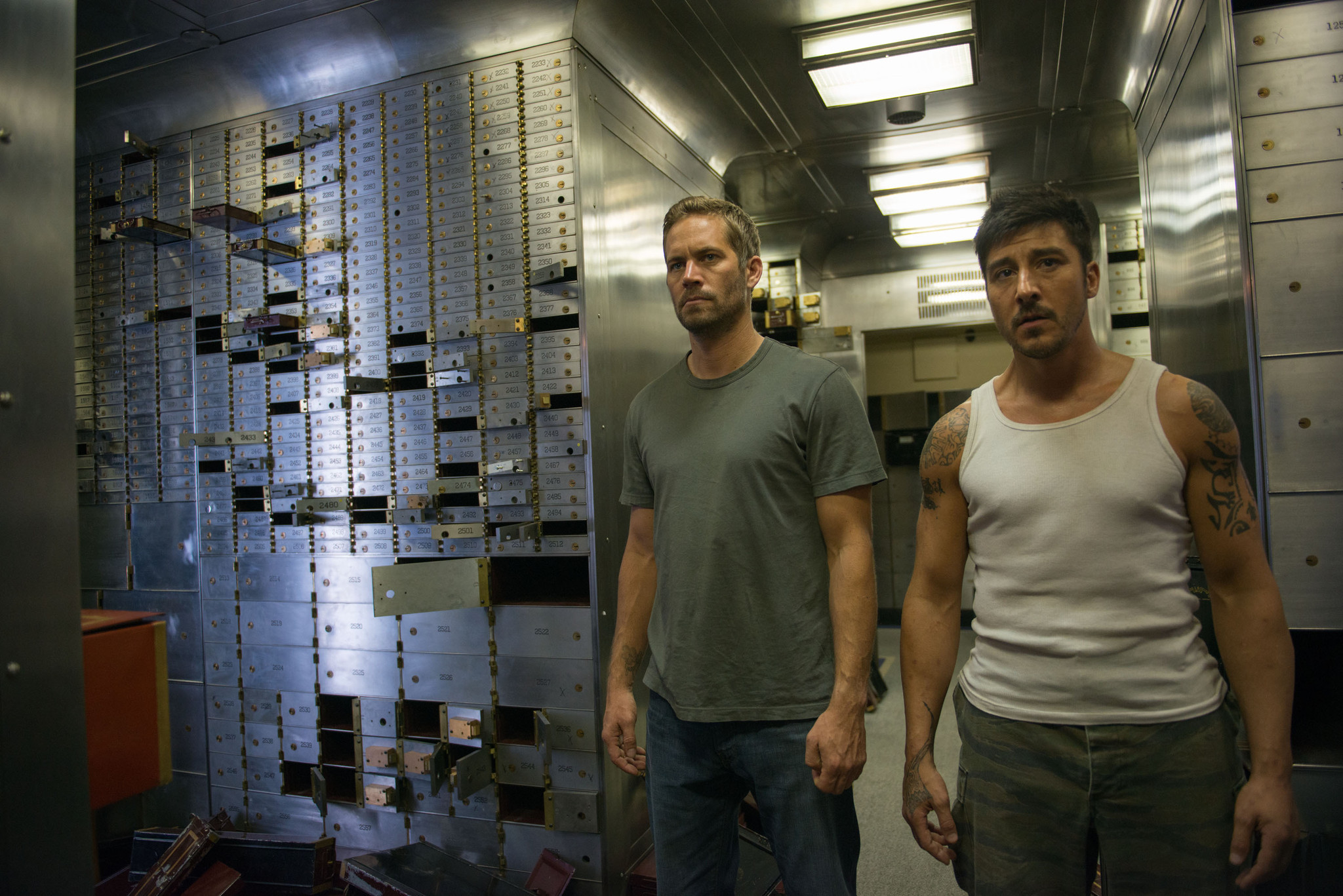 Review 39 brick mansions 39 collapses into incoherence la times for Brick city motors reviews