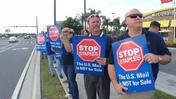 U.S. Postal Service workers protest Staples