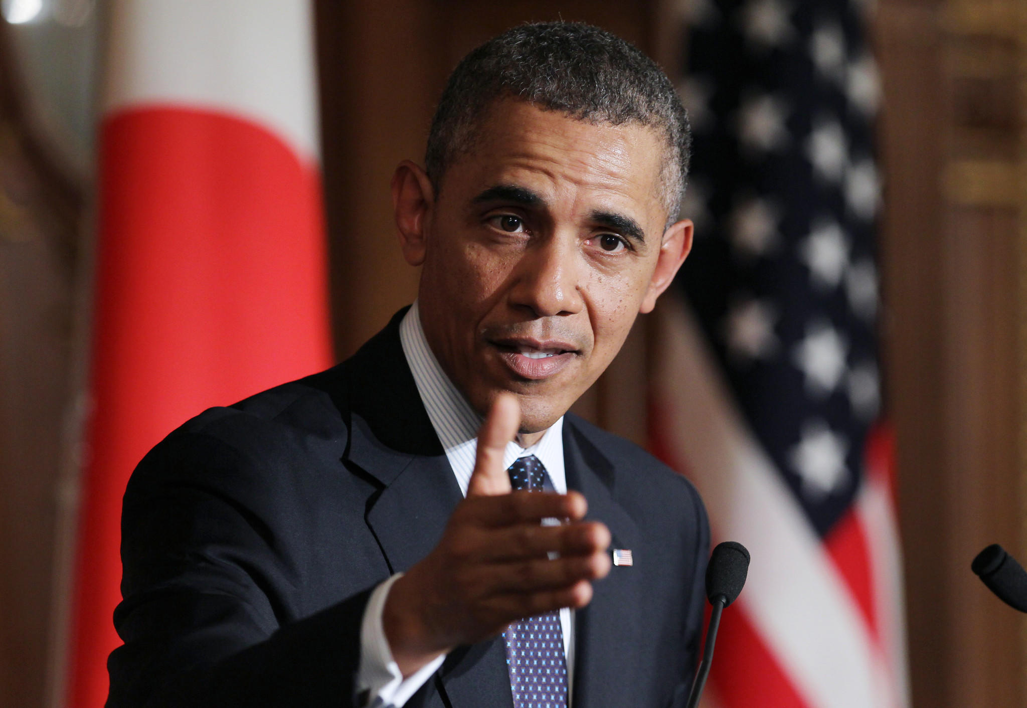 President Obama, speaking at a news conference in Japan, said the U.S. and its allies have additional sanctions against Russia ready to go.