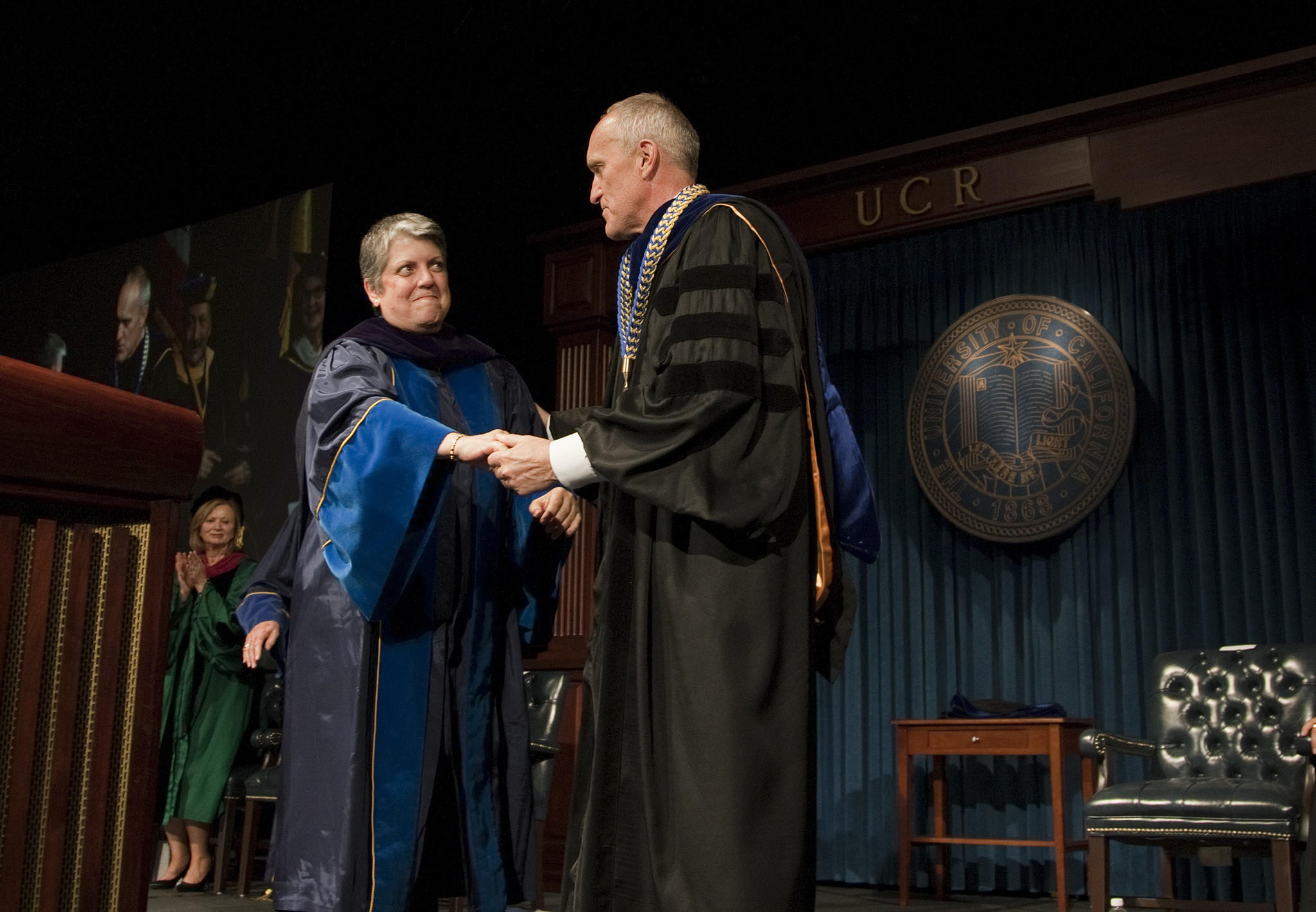 University of California President Janet Napolitano, left, congratulates new UC Riverside Chancellor Kim Wilcox at his investiture ceremony.