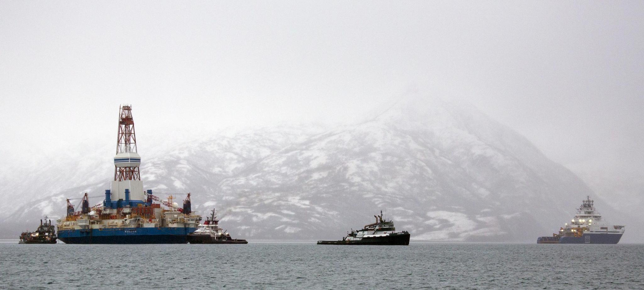 Salvage teams conduct an assessment of Shell's Kulluk drill barge in January 2013 in Kodiak Island's Kiliuda Bay in Alaska. A federal judge in Alaska told regulators April 24, 2014, to redo an environmental impact study that underestimated the amount of recoverable oil and, potentially, the risks of offshore drilling to delicate Arctic habitat.
