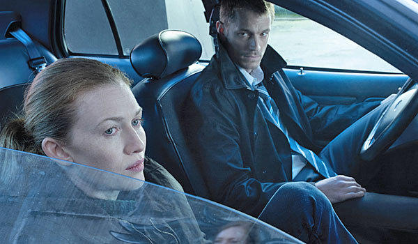 "Mireille Enos and Joel Kinnaman play Seattle detectives in ""The Killing."""
