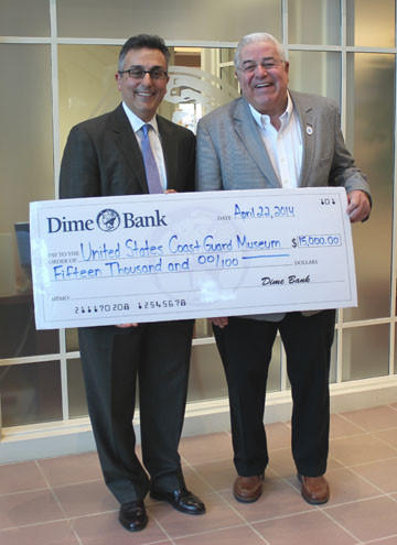 From left to right: Nick Caplanson, president & CEO, Dime Bank; and John S. Johnson, treasurer, National Coast Guard Museum Association, Inc.