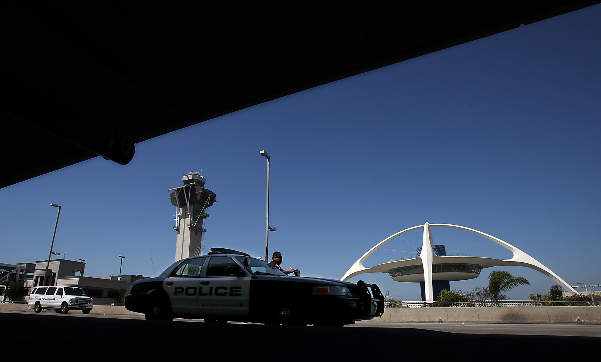 A Los Angeles Airport Police Department officer parks his patrol car outside Terminal 6. The family of a Transportation Security Administration officer slain in a shooting at LAX has filed a claim against the city, alleging the wrongful death of Gerardo Hernandez and seeking damages in excess of $25 million.
