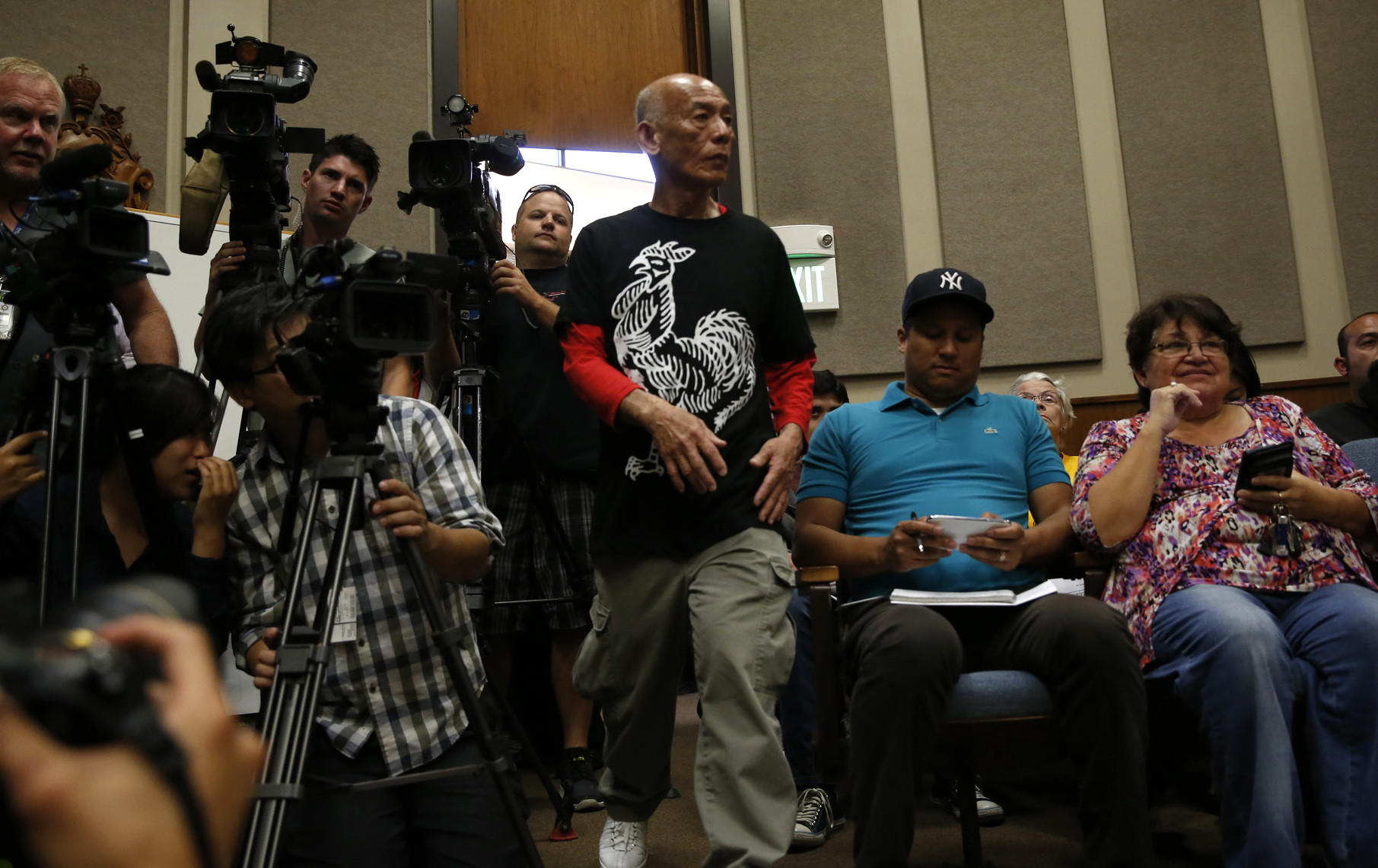 Sriracha plant owner David Tran arrives at the Irwindale city council meeting.