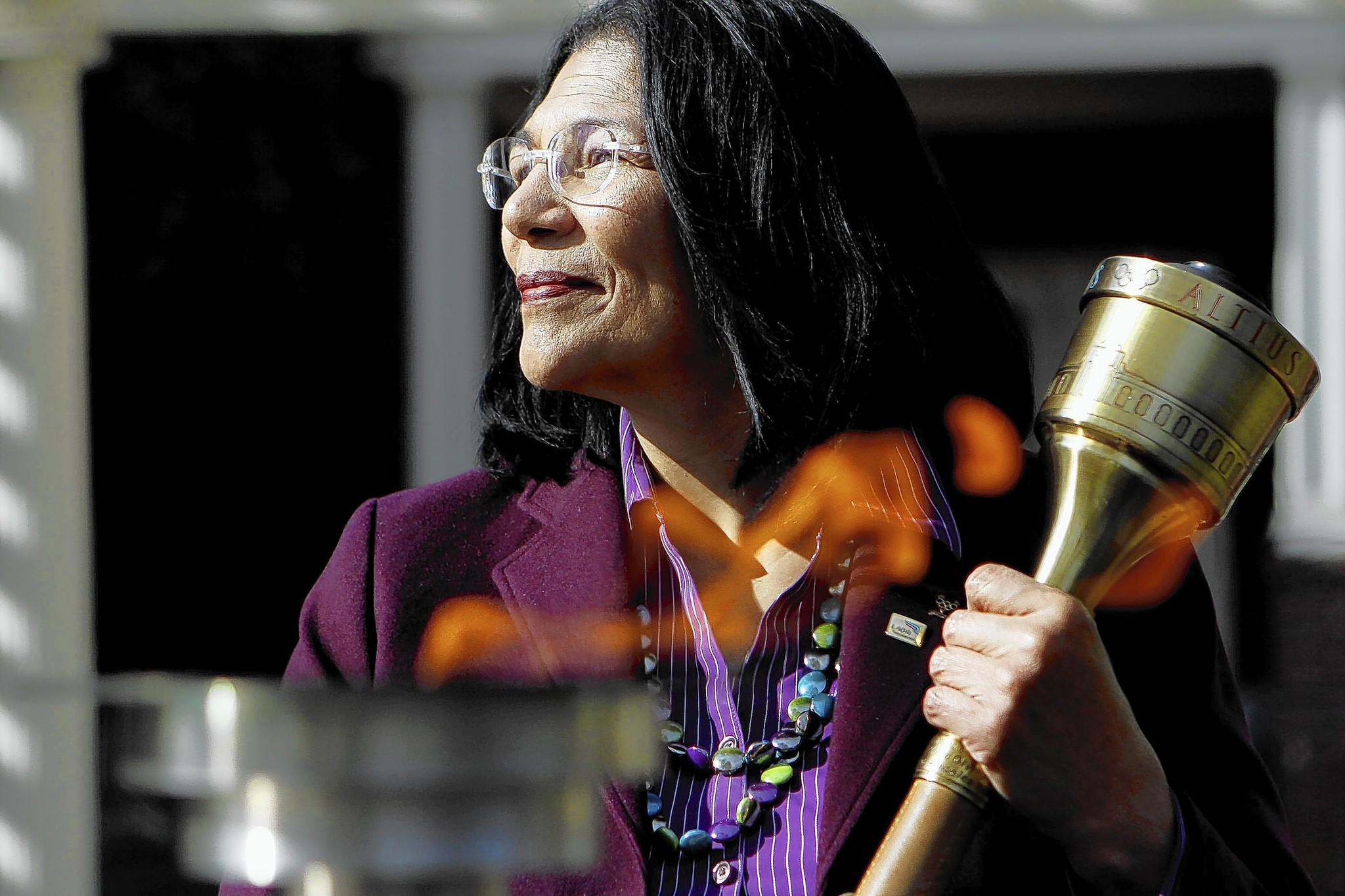 """We overlook it as something children do. As adults, we view it as entertainment. But there is an intrinsic value to sport, not only in teaching teamwork,"" says Anita L. DeFrantz, 61, president and a director of the LA84 Foundation. Above, DeFrantz holds an Olympic torch at the foundation in January."
