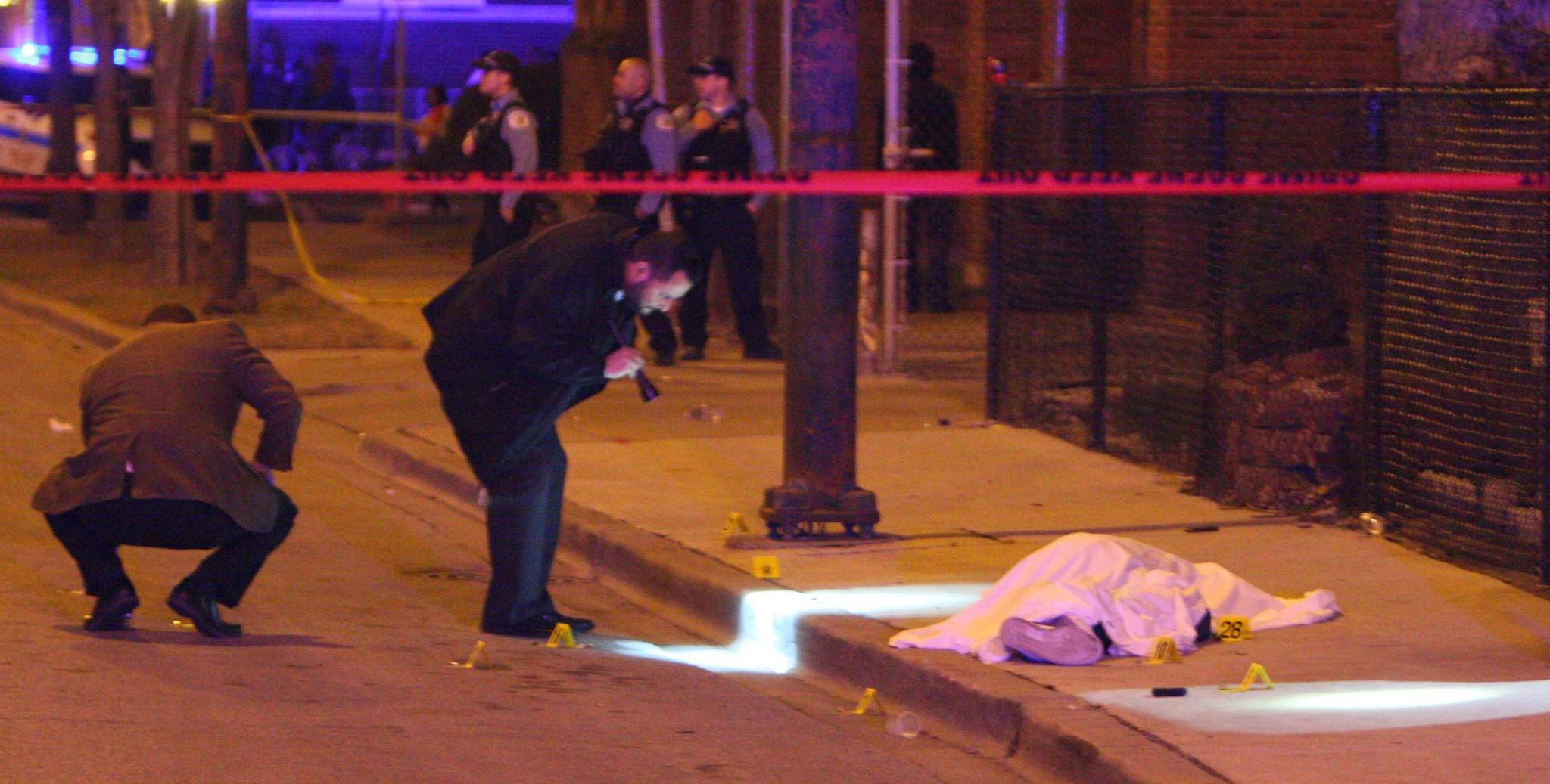 Chicago police investigate a fatal shooting at 83rd Street and Morgan Avenue.
