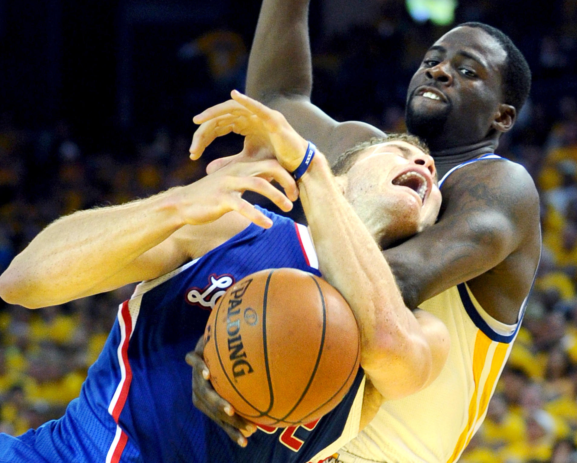 Clippers power forward Blake Griffin is fouled by Warriors power forward Draymond Green on a drive to the basket in the first half Thursday night in Oakland.