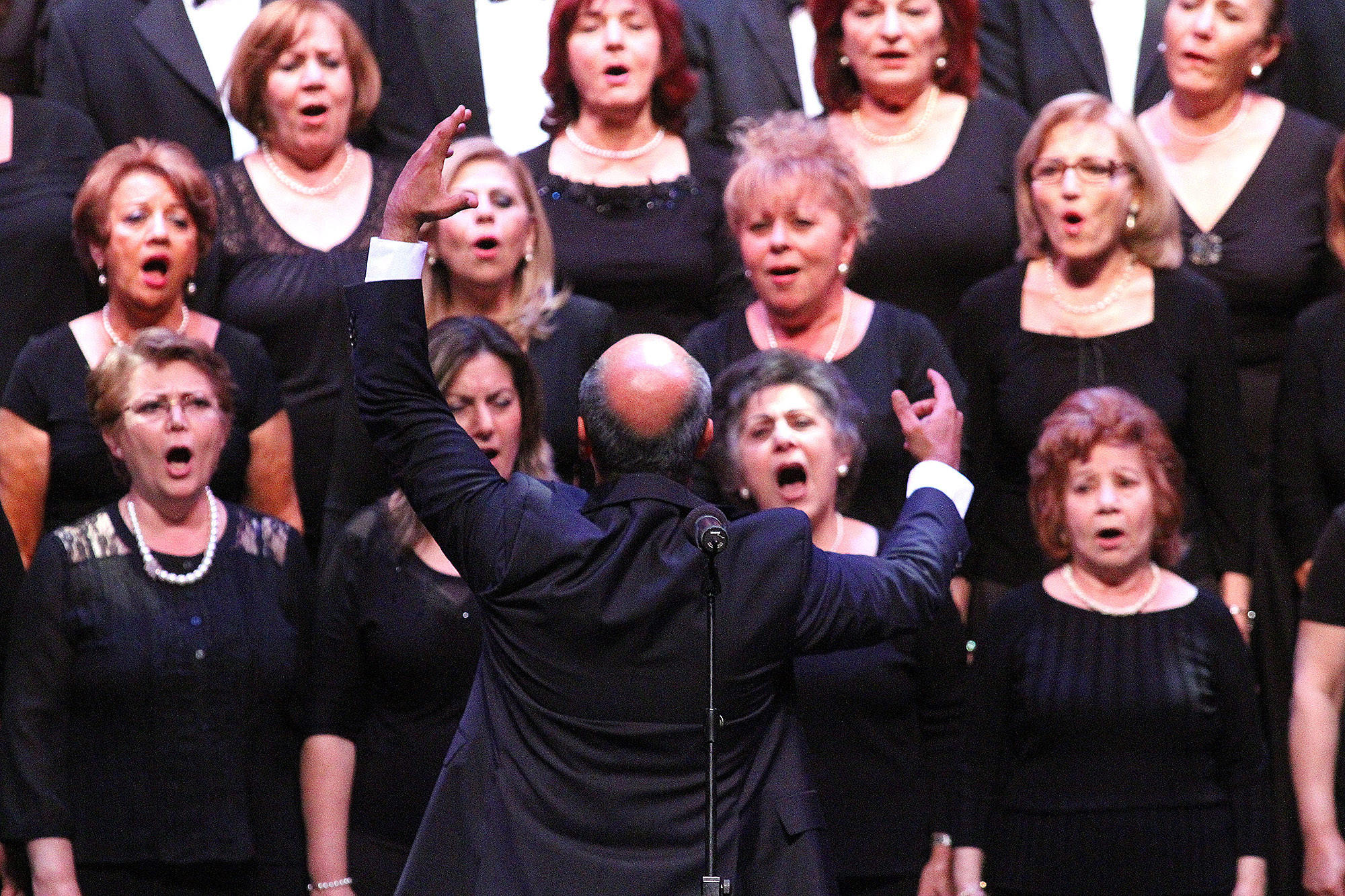 Director Michael Avedissian brings out the power of the voices of the Armenian Society of Los Angeles Choir at the City of Glendale's 13th Annual Commemoration of the Armenian Genocide at the Alex Theatre in Glendale on Thursday, April 24, 2014.