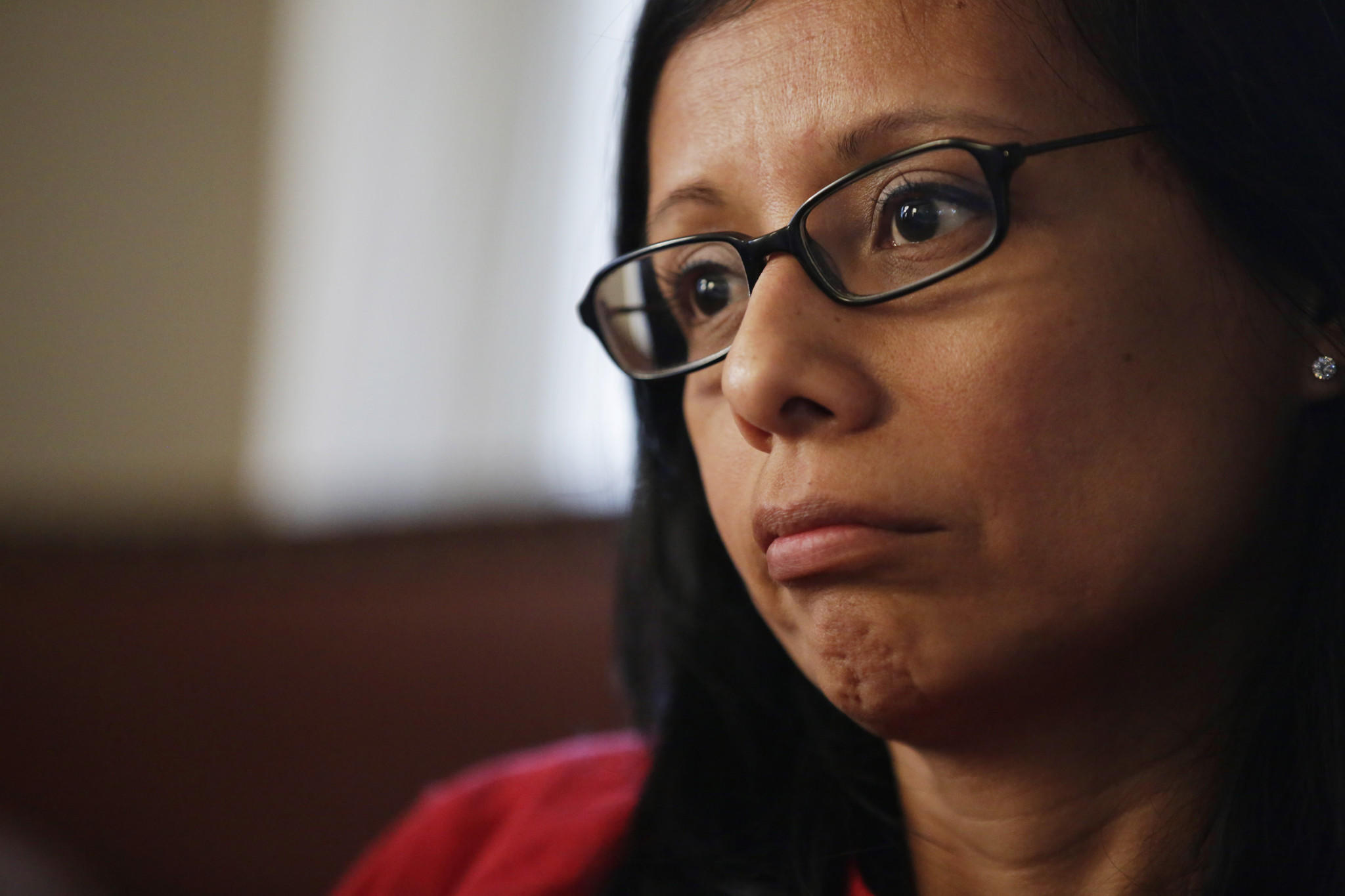 Cecilia M. Garcia pauses during an emotional interview as she speaks about her son, Joaquin Garcia, who was killed in a car crash last year on April 22, 2014 in Elgin.
