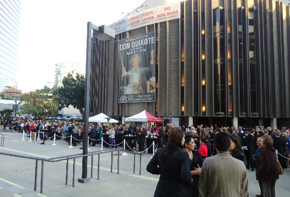 """San Diego Opera patrons gather outside the Civic Theatre in downtown San Diego before a recent performance of """"Don Quixote."""""""