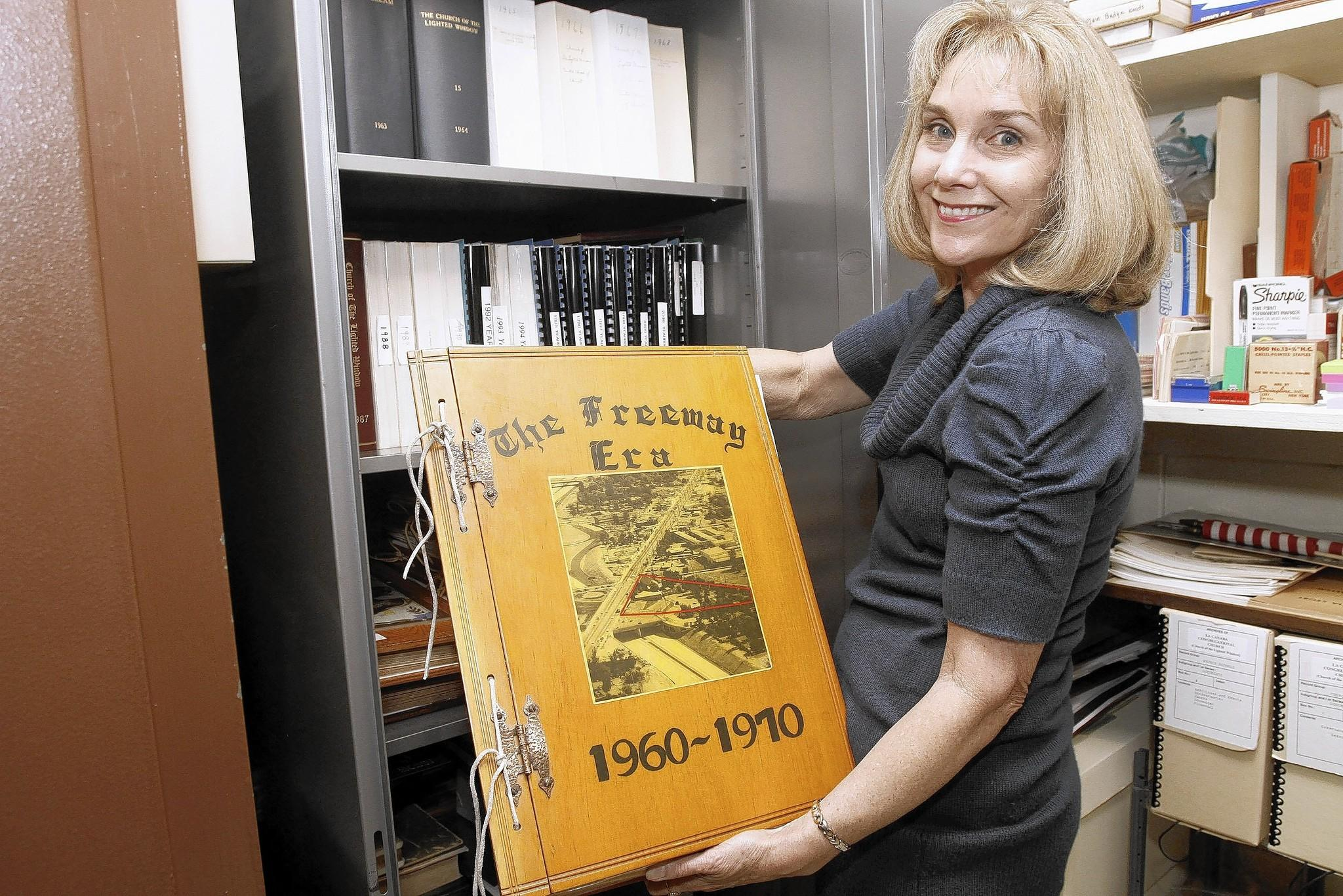 La Cañada Congregational Church book committee member Carol Kulluk shows a 50-year-old scrapbook at the church in La Cañada Flintridge on Tuesday, April 22, 2014.