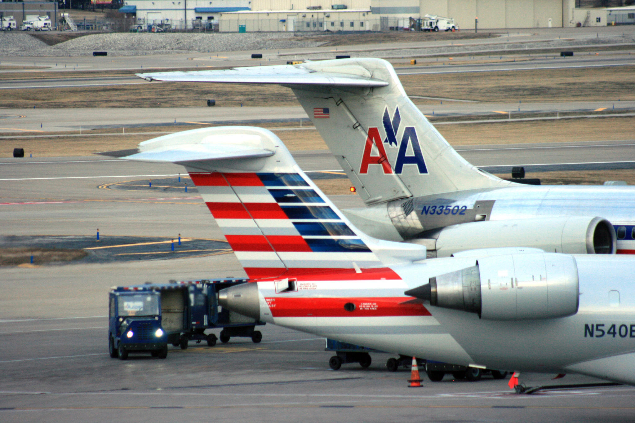 Flight delays and cancellations increase when airline competition drops, a new study says. Above, two American Airlines jets in St. Louis in December 2013.