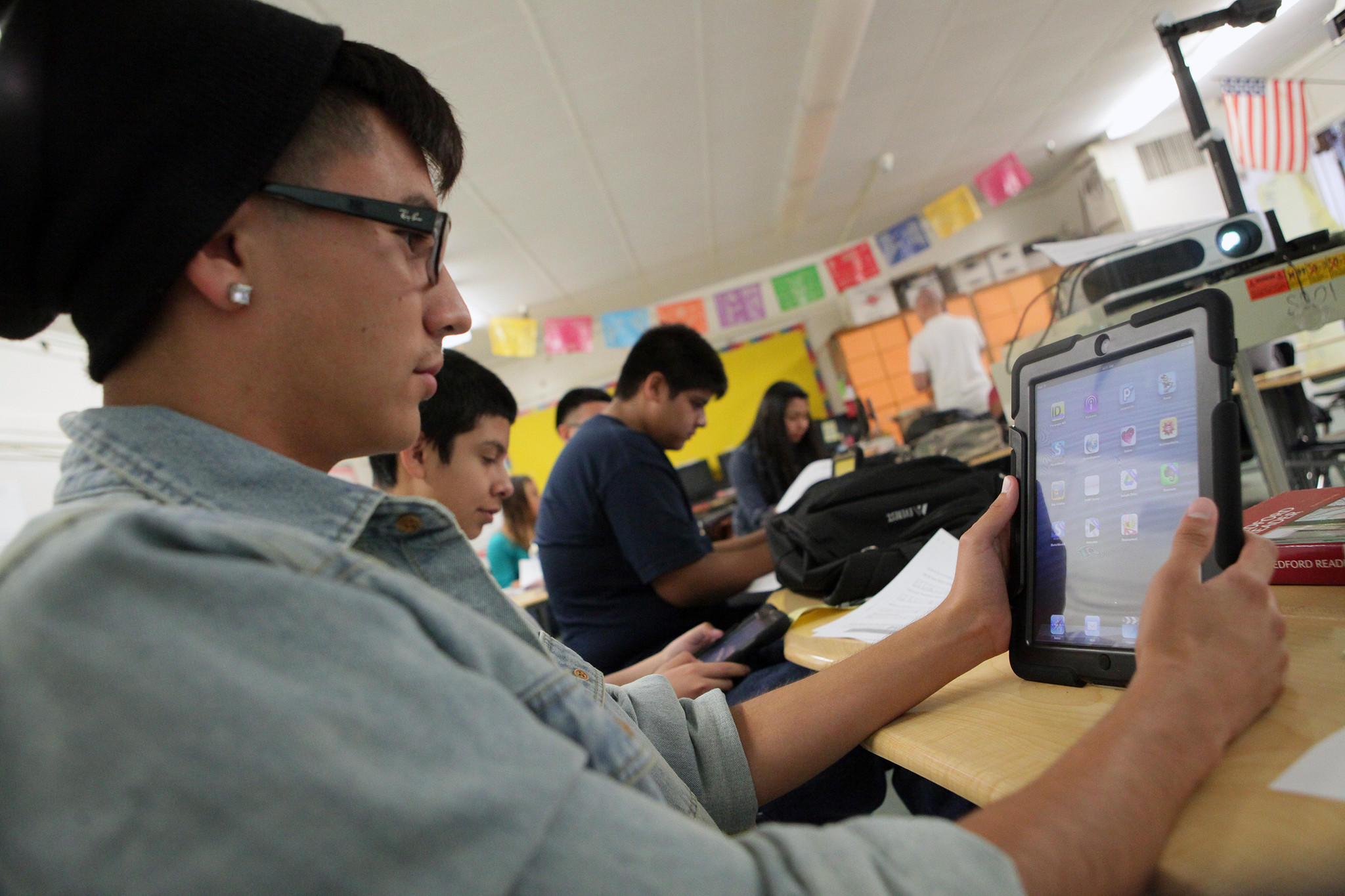 Students at Roosevelt High in Boyle Heights use iPads provided by the school district.