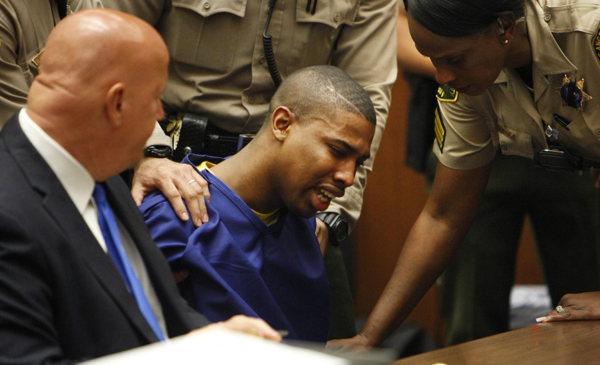 Brandon Spencer breaks down in a Los Angeles courtroom during his sentencing April 18.